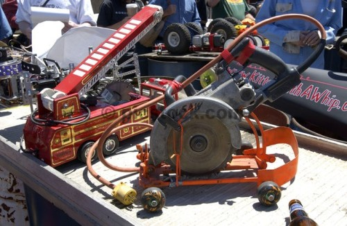 For the third consecutive year, mechanic enthusiasts gathered in a San Francisco junkyard with their modified power tool machines to race side-by-side down a 75-foot wooden track. Most machines, attached to electrical cords, were based on common power tools such as circular saws, grinders, drills and belt sanders fitted with wheels. While most contestants competed for fun and for the underground type atmosphere, some hoped to win the $1,000 final grand prize.